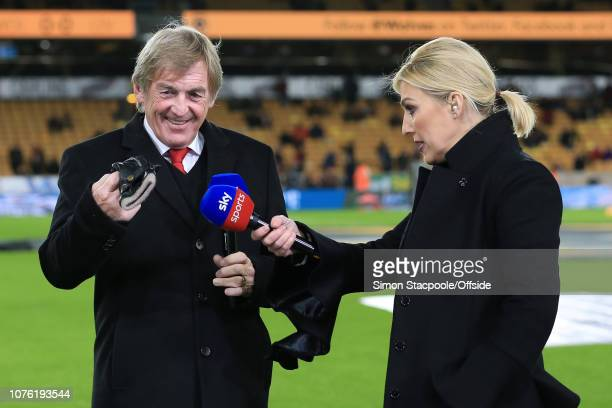Liverpool legend Kenny Dalglish shares a joke with his daughter Sky Sports television presenter Kelly Cates ahead of the Premier League match between...