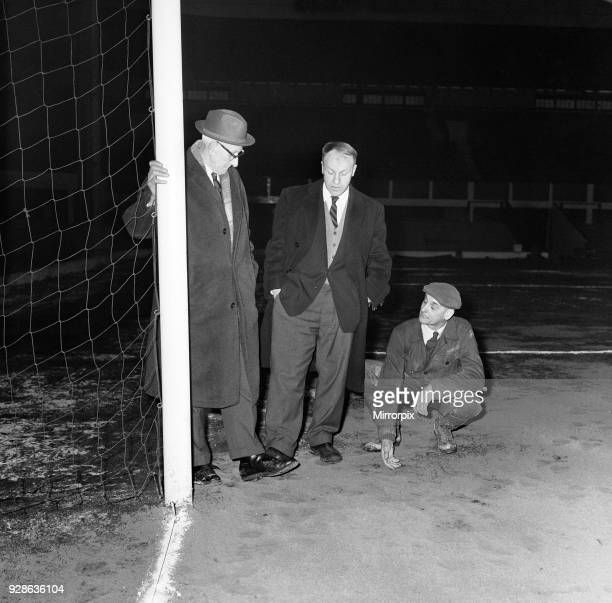 Liverpool manager Bill Shankly inspecting the Anfield pitch with chairman T V Williams and head groundsman Arthur Riley after referee George McCabe...