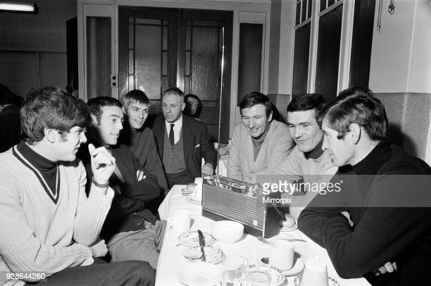 Liverpool manager Bill Shankly listening to the FA Cup draw with some of his players over lunch at their ground They are Alun Evans Ian St John Emlyn...