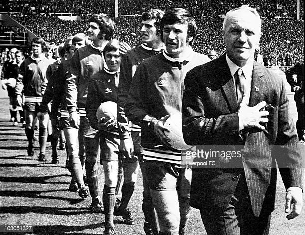 Liverpool manager Bill Shankly proudly holds his chest as he leads his men out into the sunlight prior to the FA Cup Final between Liverpool and...
