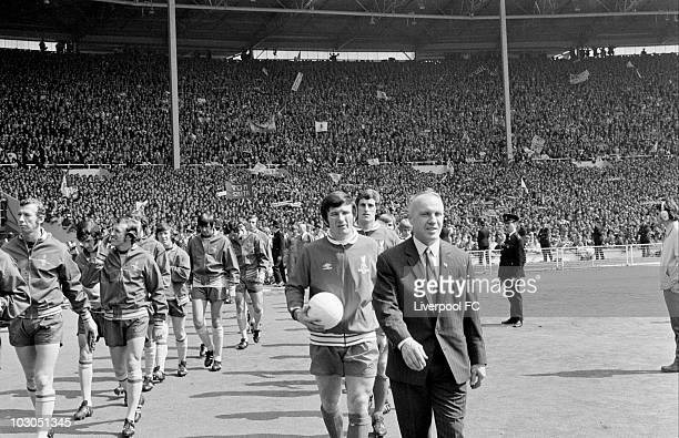 Liverpool manager Bill Shankly proudly leads his men out into the sunlight prior to the FA Cup Final between Liverpool and Arsenal held on May 8 1971...