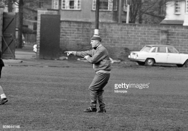 Liverpool manager Bill Shankly wearing a new tracksuit and hand knitted woolly hat directs his team during a training session at Melwood, 15th...