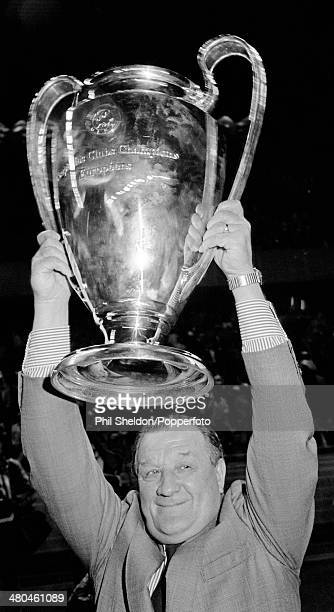 Liverpool Manager Bob Paisley lifts the trophy after their 10 victory over Real Madrid in the European Cup Final at the Parc des Princes in Paris...