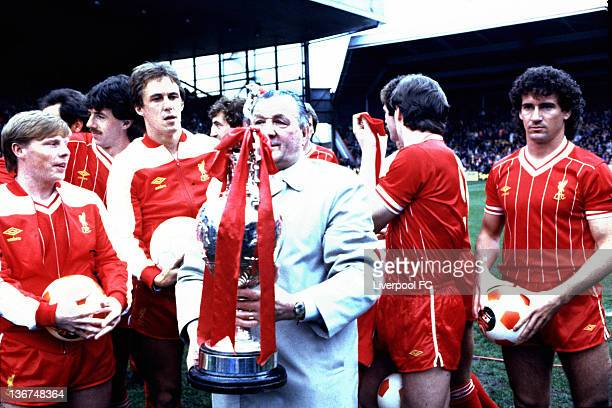 Liverpool manager Bob Paisley poses with the winning First Division League Championship trophy in his last season in charge of the club with his...