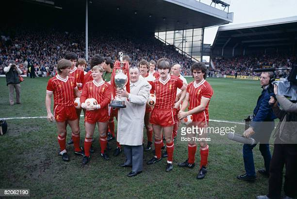 Liverpool Manager Bob Paisley, surrounded by his players, holds the First Divison Championship Trophy, prior to their match against Aston Villa at...