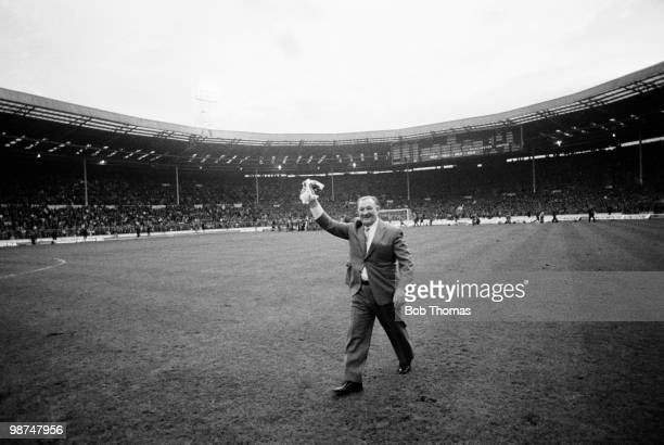 Liverpool manager Bob Paisley waves to the crowd as he leaves the field after the Football League Milk Cup Final against Manchester United at Wembley...
