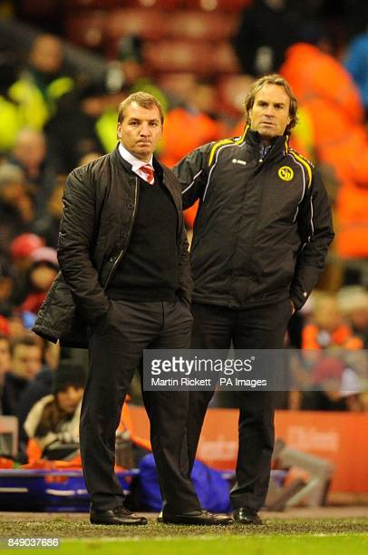 Liverpool manager Brendan Rodgers and Young Boys manager Martin Rueda on the touchline
