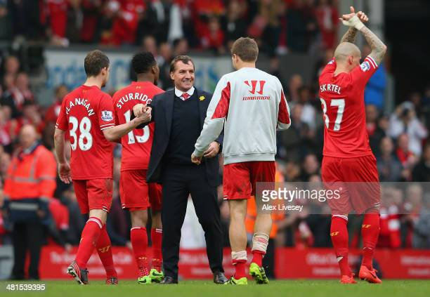 Liverpool Manager Brendan Rodgers congratulates Jon Flanagan and Steven Gerrard of Liverpool at the end of the Barclays Premier League match between...