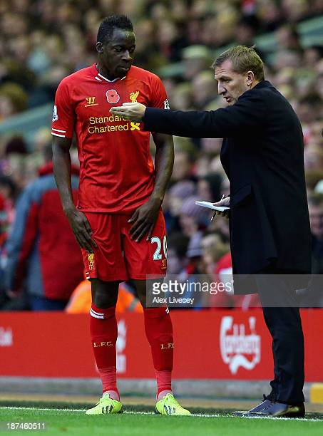 Liverpool Manager Brendan Rodgers gives instructions to Aly Cissokho during the Barclays Premier League match between Liverpool and Fulham at Anfield...