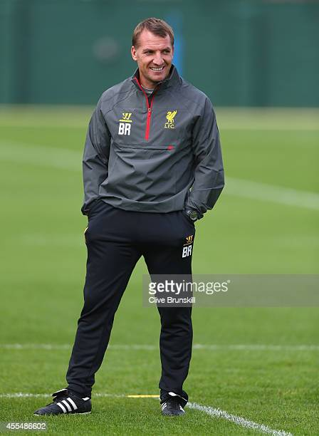 Liverpool manager Brendan Rodgers looks on in good spirits during a training session ahead of their UEFA Champions League group B match against PFC...