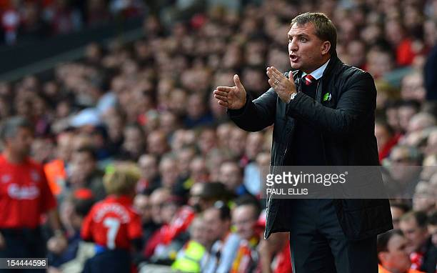 Liverpool manager Brendan Rodgers talks to his players during their English Premier League football match against Reading at Anfield in Liverpool...