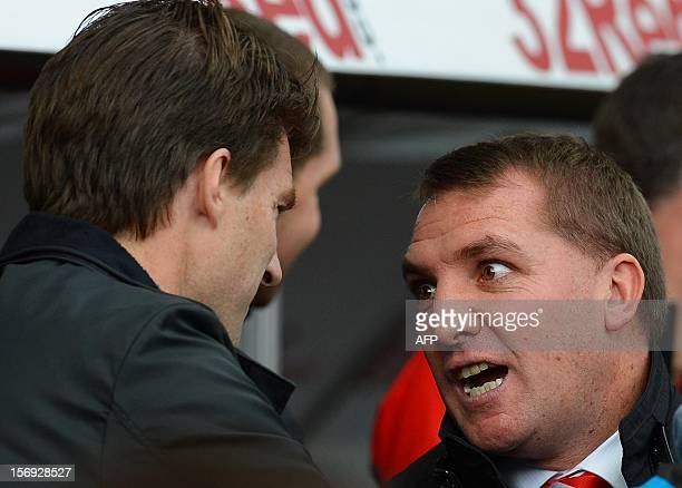 Liverpool manager Brendan Rodgers talks to Swansea City manager Michael Laudrup before the English Premier League football match between Swansea City...