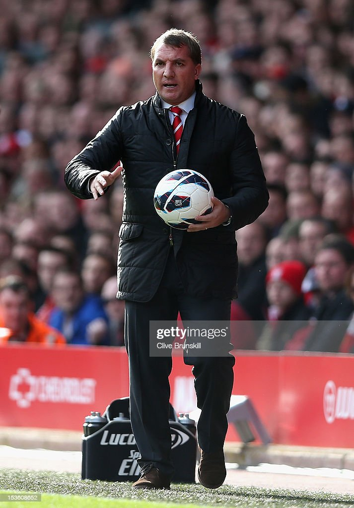 Liverpool Manager Brendan Rogers retrieves the ball during the Barclays Premier League match between Liverpool and Stoke City at Anfield on October 7, 2012 in Liverpool, England.