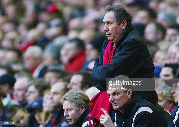 Liverpool Manager Gerard Houlier and watches his team during the FA Barclaycard Premiership match between Liverpool and Aston Villa at Anfield on...