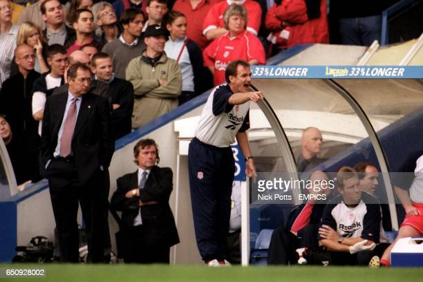 Liverpool manager Gerard Houllier looks on as his assistant Phil Thompson barks out the orders