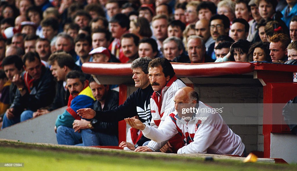 Liverpool manager Graeme Souness (c) with backroom staff Phil Boersma (l) and Ronnie Moran (r) in the Anfield dug out during a match circa 1991 in Liverpool, England.