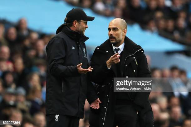 Liverpool Manager / Head Coach Jurgen Klopp exchanges views with Manchester City Manager / Head Coach Josep Guardiola during the Premier League match...
