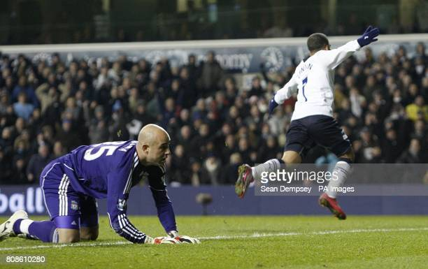 Liverpool manager Jose Reina looks dejected as Tottenham Hotspur's Aaron Lennon celebrates scoring the winning goal of the game