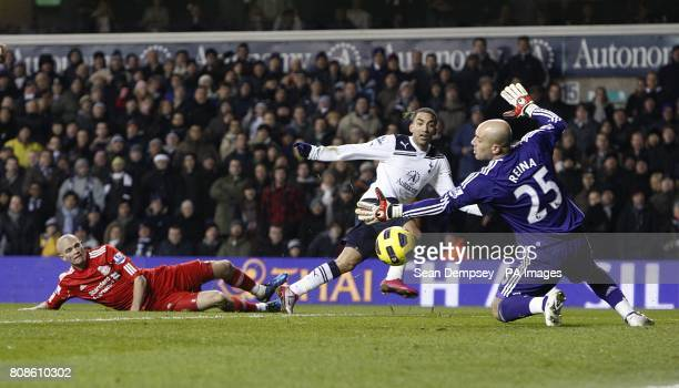 Liverpool manager Jose Reina stretches to save as Tottenham Hotspur's Aaron Lennon has a shot on goal