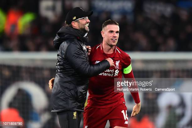 Liverpool manager Jürgen Klopp celebrates at the end of the match with Liverpool's Jordan Henderson during the UEFA Champions League Group C match...