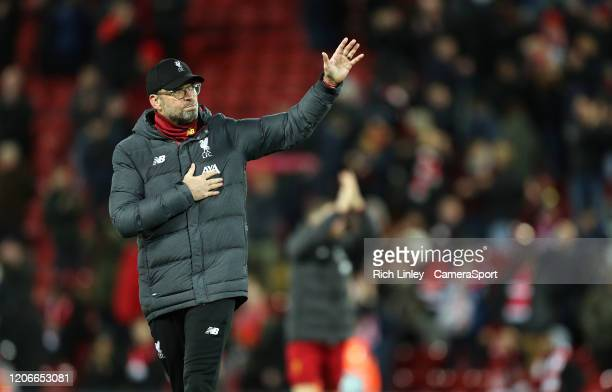 Liverpool manager Jurgen Klopp acknowledges the Anfield crowd with a wave as his side exit the Champions League following the UEFA Champions League...