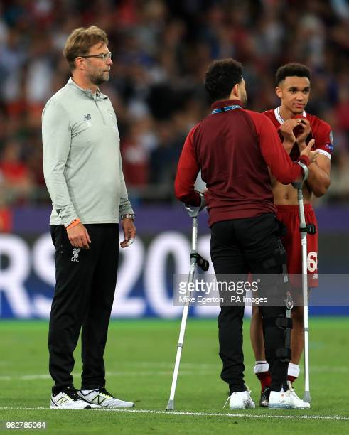 Liverpool manager Jurgen Klopp Alex OxladeChamberlain and Trent AlexanderArnold appears dejected after the final whistle during the UEFA Champions...