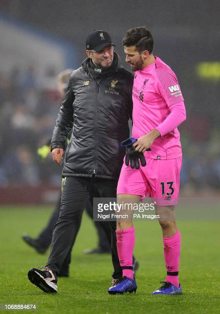 Liverpool manager Jurgen Klopp and goalkeeper Alisson react after the final whistle during the Premier League match at Turf Moor Burnley