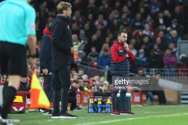 Liverpool manager Jurgen Klopp and Leon Britton of Swansea City during the Premier League match between Liverpool and Swansea City at Anfield on...