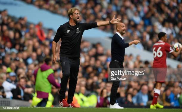 Liverpool manager Jurgen Klopp and Pep Guardiola react during the Premier League match between Manchester City and Liverpool at Etihad Stadium on...