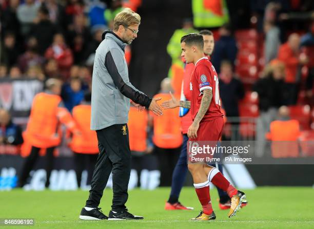 Liverpool manager Jurgen Klopp and Philippe Coutinho after the UEFA Champions League Group E match at Anfield Liverpool