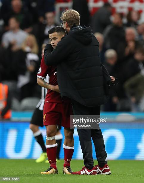 Liverpool manager Jurgen Klopp and Philippe Coutinho of Liverpool are seen seen during the Premier League match between Newcastle United and...
