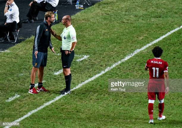 Liverpool manager Jurgen Klopp argues with Referee Bobby Madley during the Premier League Asia Trophy match between Liverpool FC and Leicester City...