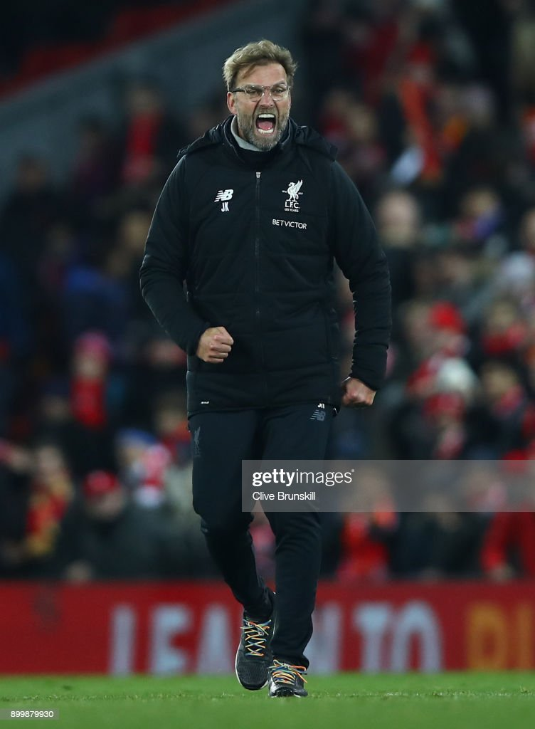 Liverpool manager Jurgen Klopp celebrates his teams victory at the final whistle during the Premier League match between Liverpool and Leicester City at Anfield on December 30, 2017 in Liverpool, England.
