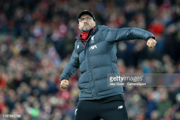 Liverpool manager Jurgen Klopp celebrates scoring the opening goal after the FA Cup Third Round match between Liverpool and Everton at Anfield on...