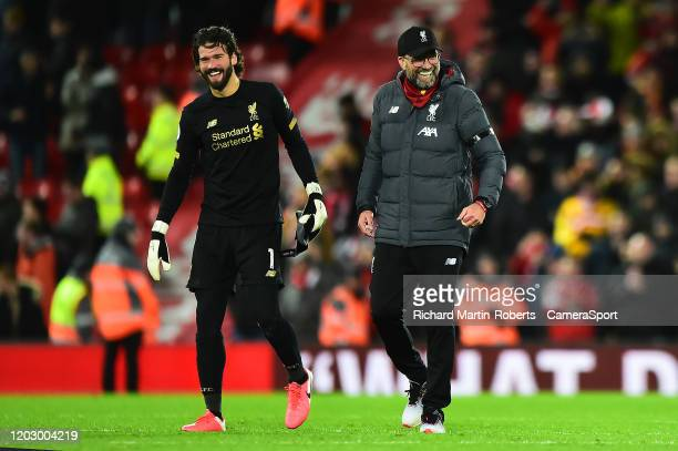 Liverpool manager Jurgen Klopp celebrates with Alisson Becker at the end of the match during the Premier League match between Liverpool FC and West...