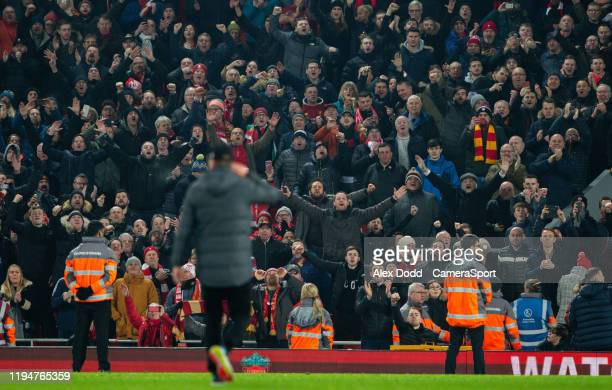 Liverpool manager Jurgen Klopp celebrates with fans after the game during the Premier League match between Liverpool FC and Manchester United at...