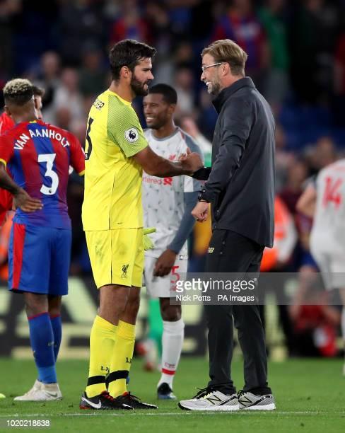Liverpool manager Jurgen Klopp celebrates with goalkeeper Alisson Becker after the Premier League match at Selhurst Park London
