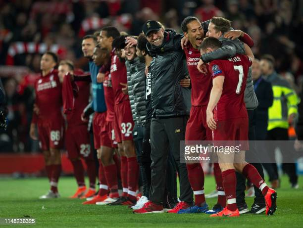 Liverpool manager Jurgen Klopp celebrates with his players after the UEFA Champions League Semi Final second leg match between Liverpool and...