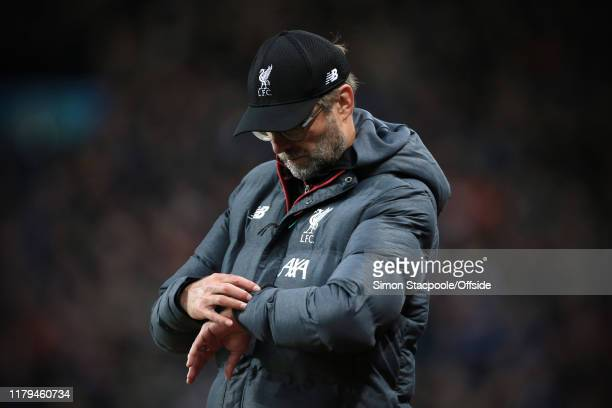Liverpool manager Jurgen Klopp checks his watch during the Premier League match between Aston Villa and Liverpool FC at Villa Park on November 2 2019...