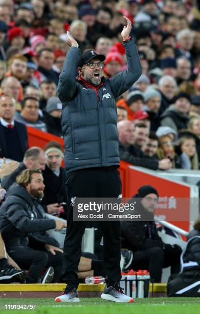 Liverpool manager Jurgen Klopp cheers his side on during the FA Cup Third Round match between Liverpool and Everton at Anfield on January 5 2020 in...