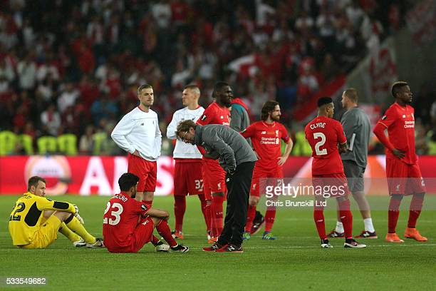 Liverpool manager Jurgen Klopp consoles Emre Can following the UEFA Europa League Final match between Liverpool and Sevilla at St JakobPark on May 18...