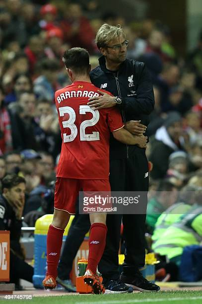 Liverpool manager Jurgen Klopp embraces Cameron Brannagan as he leaves the field after being substituted during the Capital One Cup Fourth Round...