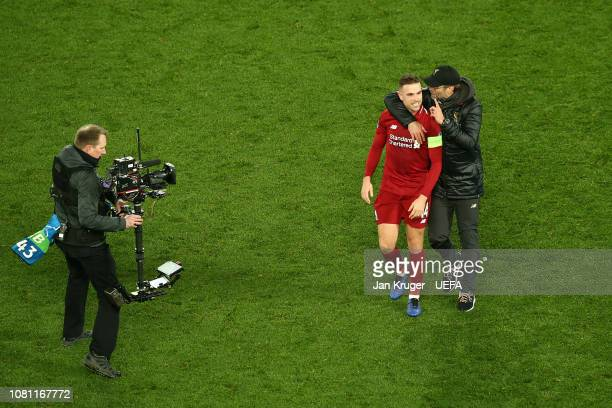 Liverpool manager Jurgen Klopp embraces Jordan Henderson of Liverpool at the final whistle during the UEFA Champions League Group C match between...