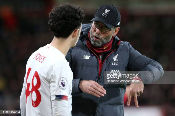 Liverpool manager Jurgen Klopp goes over tactics with Curtis Jones during the Premier League match between AFC Bournemouth and Liverpool FC at...