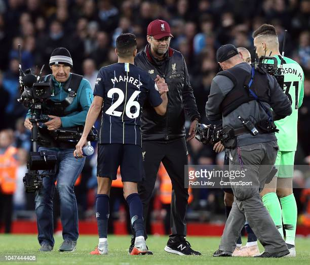 Liverpool manager Jurgen Klopp greets Manchester City's Riyad Mahrez at the final whistle during the Premier League match between Liverpool FC and...