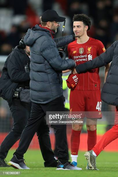 Liverpool manager Jurgen Klopp hugs Curtis Jones of Liverpool after the FA Cup Third Round match between Liverpool and Everton at Anfield on January...