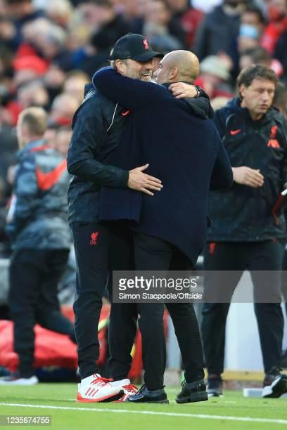 Liverpool manager Jurgen Klopp hugs Manchester City manager Pep Guardiola after the Premier League match between Liverpool and Manchester City at...