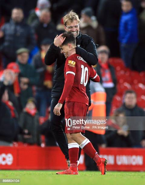 Liverpool manager Jurgen Klopp hugs Philippe Coutinho after the Premier League match at Anfield Liverpool