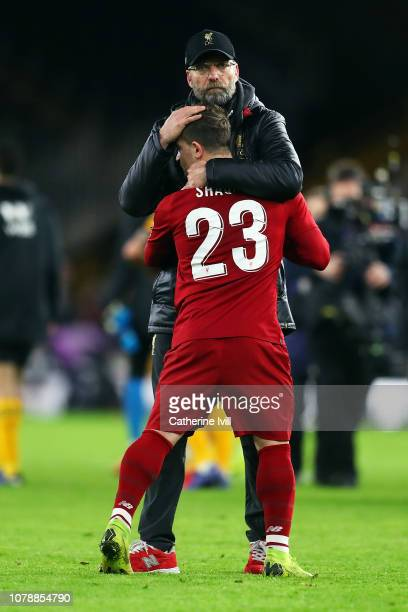 Liverpool Manager Jurgen Klopp hugs Xherdan Shaqiri after losing the Emirates FA Cup Third Round match between Wolverhampton Wanderers and Liverpool...