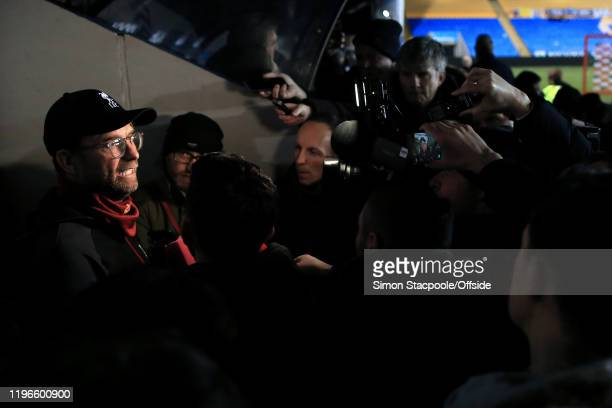 Liverpool manager Jurgen Klopp is surrounded by members of the media as he is interviewed after the FA Cup Fourth Round match between Shrewsbury Town...